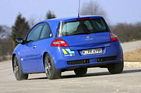 Renault Megane 2.0 16V Turbo, model year 2006_, blue moving, diagonal from the back, rear view, Test track