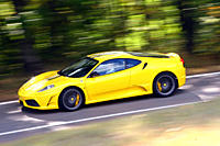 Ferrari 430 Scuderia, model year 2007_, yellow, driving, side view, country road