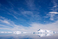 The Lindblad Expeditions ship National Geographic Explorer pushes through ice in Crystal Sound, south of the Antarctic Circle, Antarctica, Southern Oc...