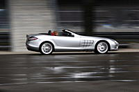 Mercedes SLR McLaren, model year 2008_, silver, driving, side view, City, open top