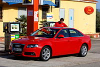 Audi A4 1.8 TFSI Ambition, model year 2007_, red, standing, upholding, diagonal from the front, frontal view, City, Gas station