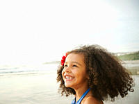 Smiling mixed race girl on beach