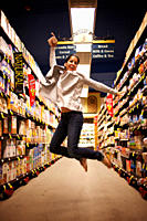 Hispanic woman jumping in grocery store