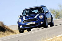 Mini Cooper S Clubman, model year 2007_, blue moving, diagonal from the front, frontal view, country road