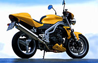 Street motor cycle, Naked Bike, Triumph Speed Triple, yellow, model year 2003, standing, upholding, diagonal from the back, side view, photographer Ga...