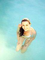 Caucasian woman enjoying swimming pool
