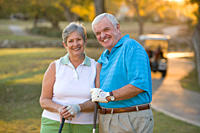 Caucasian couple standing on golf course
