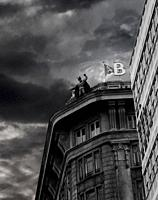 Batman watching over the city, threatening evil.  At 2005 A Coruña´s Comic festival, Spain Batman, Superman and other superheroes human size figures w...