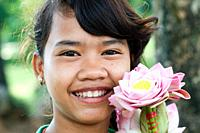 Flower hawker at Ta Prohm temple ruins, Takeo, Cambodia