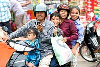 Family on motor bike, Phnom Penh, Cambodia