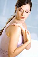 woman,female,person,caucasian,pain,neck,back, shoulders,muscle tenseness,tenseness,pains,ache,touch,touching,underwear,indisposition'indispositions'na...