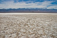 Death Valley National Park with salt flats and distant mountains and clouds