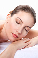 Close up of woman having spa treatment, eyes closed