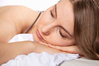Close up of woman sleeping on bed