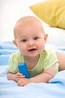 Baby boy 6_11 months lying, smiling, portrait