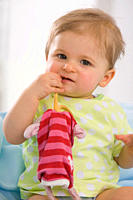 Baby girl 6_11 months playing with toy, portrait