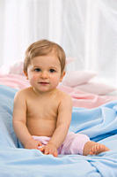 Baby girl 6_11 months sitting on blanket, portrait