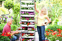 Couple buying flowers in nursery