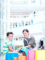 Mother and son with shopping bags in mall