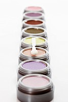 Multi coloured eye shadows with make up brush, close up