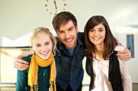 Germany, Leipzig, University students enjoying together, smiling, portrait