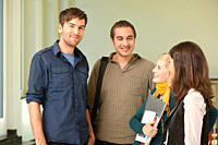 Germany, Leipzig, University students talking in university, smiling