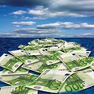 100 euro banknote floating on sea, close_up
