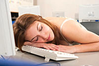 Germany, Emmering, Teenage girl sleeping in computer lab