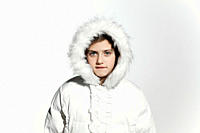 Girl wearing a white coat with fur hood (thumbnail)