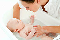 Mother bathing baby