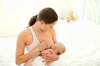 Mother breast feeding baby son