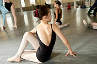 Girl doing exercise in ballet class