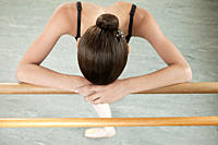 Ballerina resting on barre