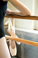 Close up on ballerina and ballet shoes