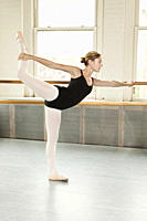 Ballerina with leg raised
