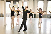 Teacher and ballet dancers