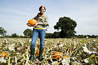 Young woman holding pumpkin (thumbnail)