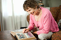 Senior woman looking at family album