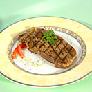 Pork steak on plate, close_up
