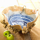 Pottery bowl with granny smith apples