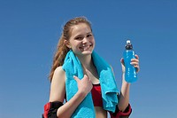 Germany, Bavaria, Teenage girl holding water bottle, portrait