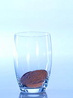 Glass of cocoa against blue background, close_up