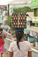 woman carrying eggs on her head across Friendship Bridge from Mae Sot, Thailand to Myawaddy, Myanmar Burma