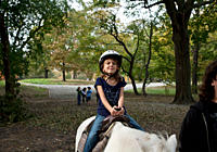 A young girl horseback riding