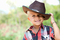 Boy tipping cowboy hat