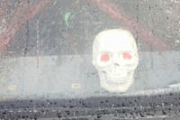 A skull behind a wet window