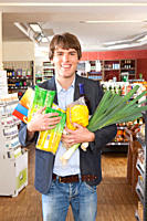 A man with an armful of groceries