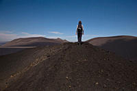 Rear view of a woman hiking over Lonquimay Volcano, Chile