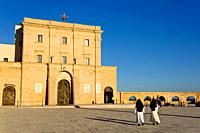 Two Catholic nuns walk towards Chiesa di Santa Maria di Leuca, Puglia, Italy