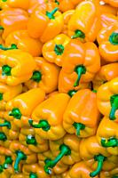 Bright yellow peppers piled up